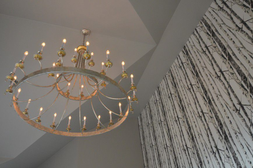 denver-interior-designers - An oversized antiqued modern chandelier to fill the peaked ceiling. Designed by Runa Novak of In Your Space Interior Design - InYourSpaceHome.com and RunaNovak.com
