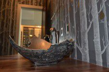 interior-designers-denver - A bronze challis sink with a tree wallpaper and matching pears in a powder room designed by Runa Novak of In Your Space Interior Design