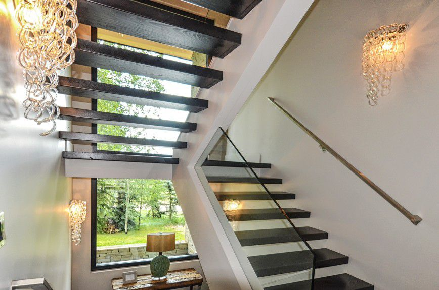 interior-design-firm-chicago - Floating staircase with metal hand rail and glass railing designed by Runa Novak of In Your Space Interior Design - InYourSpaceHome.com and RunaNovak.com