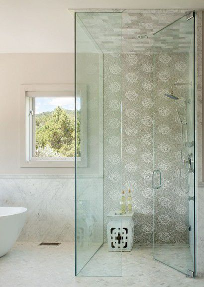 Floor to ceiling glass shower with Decorative Materials tiles designed by Runa Novak of In Your Space Interior Design - InYourSpaceHome.com and RunaNovak.com